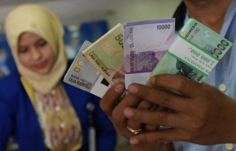 Hukum Menukar Uang saat Lebaran