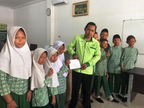 Lewat LAZISNU Banyumas, Madrasah ini Bantu Korban Tsunami Banten