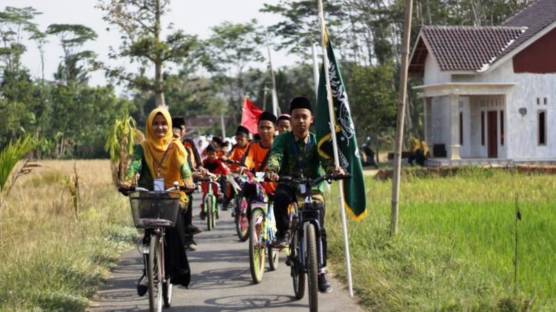 Pelajar NU Kenalkan Cinta Tanah Air dengan Keliling Kampung