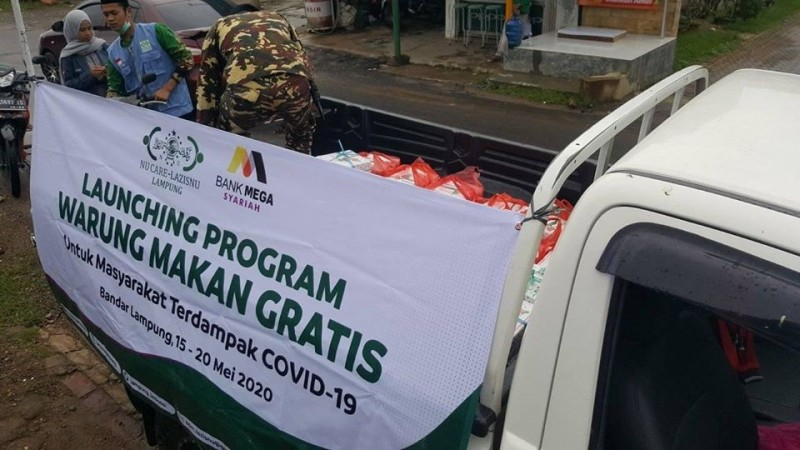 Agar Ratusan Nasi Kotak Tepat Sasaran, NU Care di Lamteng Susuri Pelosok Kampung