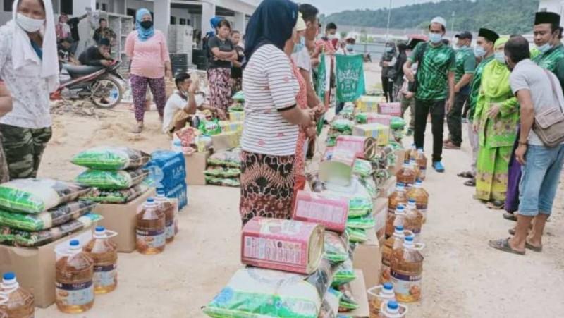 TKI Derita Musibah Kebakaran, Muslimat NU MalaysiaSerahkan Bantuan