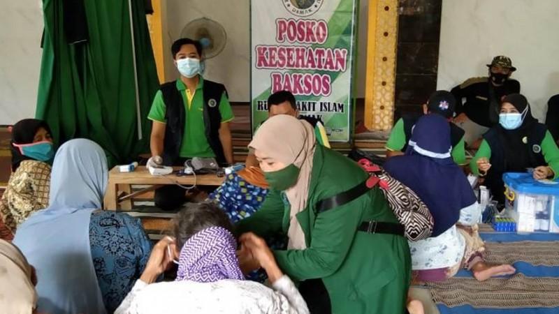RSINU dan Banser Husada Demak Gelar Pengobatan Gratis di Kawasan Banjir