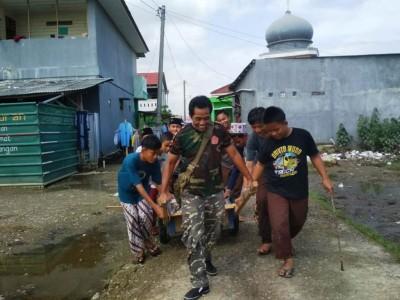 Ansor di Bekasi Beri Pengobatan Gratis dan Bersihkan Lokasi Banjir