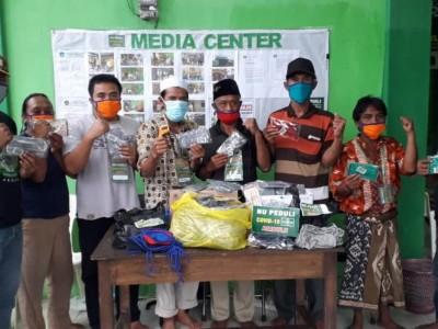 Masker Produksi Satgas NU Peduli Covid-19 Ambulu Jember Dilengkapi 'Hizb'