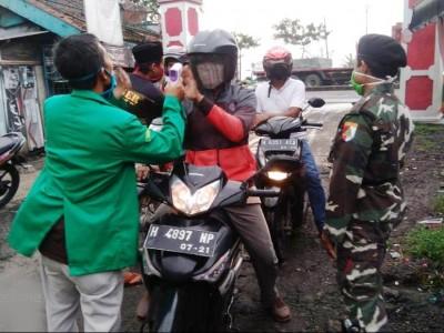 Cegah Wabah Covid-19, Banser Perketat di Perlintasan Semarang Demak