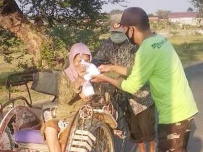 Jumat Berkah, Ansor Banser di Tegal Bagikan Ratusan Nasi Bungkus Gratis