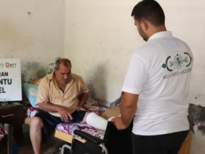 NU-Care LAZISNU distributes wheelchairs and crutches for Palestinian
